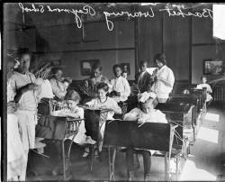 School children learn basket weaving at Raymond School, S. Wabash and E. 36th Place in the Douglas community of Chicago, 1914. Photograph from Chicago Daily News. Want a copy of this photo?  > Visit our Rights and Reproductions Department and give them this number: DN-0063339. Connect with the Museum