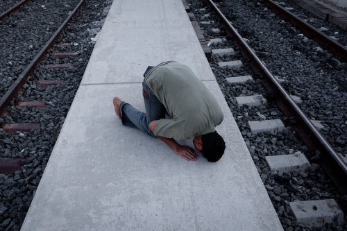 Just after crossing the border between Greece and Turkey, an Afghan man prays by the railway while waiting for the train to take him to Athens. Photographer Zalmai has documented Afghan refugees worldwide, most recently in Greece, where they are often the victims of xenophobic discrimination and abuse.  This week, he is in New York presenting his work at several events organized by Magnum Foundation.