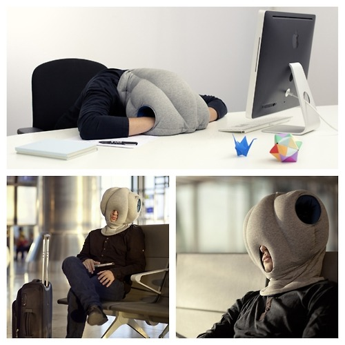 thedailyfeed:  We can't decide if this new nap-anywhere head pillow thingie is amazing or totally terrifying.   The Ostrich Pillow, the newest innovation to let you catch a power nap anywhere, is being promoted on Kickstarter, an online funding platform for creative projects.  Would you use it?  Nap Anywhere Pillow… Weird, but I want one.