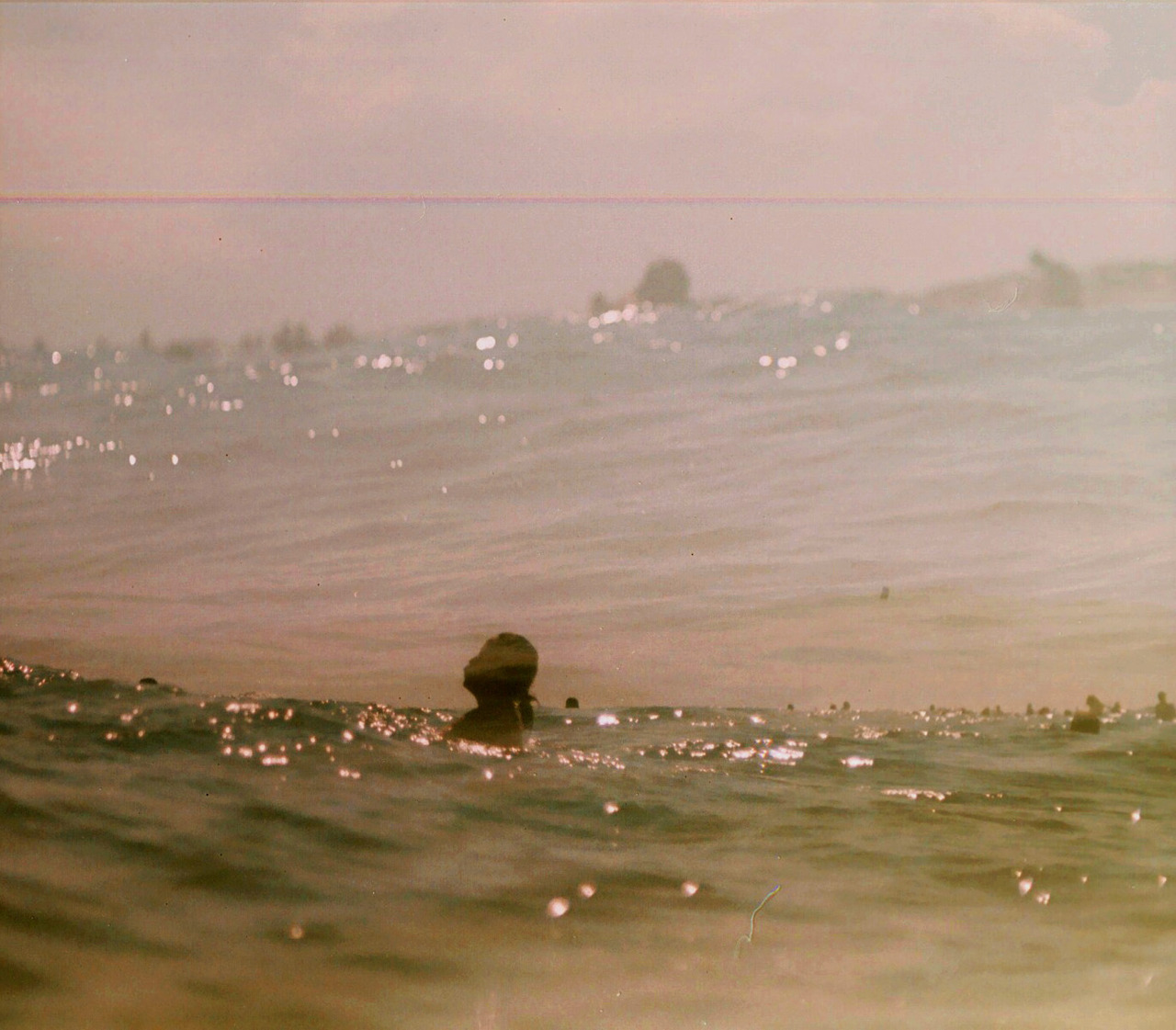 up for air.  (I took my weird, old Praktica 35mm into the ocean.  This is straight from the negative scan.) <3