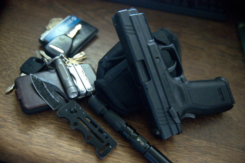 submitted by Jamie  MY EDC right to left… Springfield XD .45 (w/thumb safety) Uncle Mike's Clip-in IWB holster (Surprisingly comfortable for a cheap holster) SOG Access Card 2.0 (Great Knife, Mediocre Clip) UltraFire C3 (Rides in holster, need to replace with something more reliable) iPhone 3GS in $5 Incipio Leather case (protects great in front pocket) Keys: Leatherman Micra (backup knife) Fenix E01 (Backup Light) Basic Wallet with minimum of CC's and cash.  Editor's Note: First of all, thanks for sharing what holster you use — a lot of my readers complain that other contributors tend to overlook that piece of gear. I like how you opt for a backup light and multitool on your keychain, that's a great spot to put them, and you've picked very reliable items that serve that purpose. As for your primary light, I echo your sentiment that you could use a more reliable brand. Luckily, there are plenty of options out there. I like Fenix, EagleTac and 4sevens personally, as they put out some high quality, fairly affordable lights for EDC. Beautiful wear on that SOG, nice to see it getting use (I wouldn't be surprised, I love the action on it and if I had one I'd use it plenty). Good job keeping the wallet slim and minimal too. Overall, you've got a strong carry. Thanks for sharing!