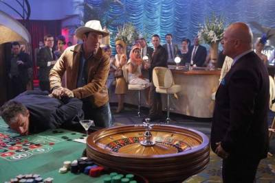 "The good news about CBS' new period drama Vegas is that it did not bring to mind the forced glamour of TV's failed Playboy Club or Pan Am retro dramas, both of which put a lot of money on screen and earnestly waved their retro bona fides—the costumes! the sets! the props!—in our faces whenever possible. The period production design in the Vegas pilot—even the expensive (see link below) casino set—was there as atmosphere, and for the most part it remained in the background. (It's far more readable in this single still image than it ever was on screen, unless you're a playback viewer who hits pause frequently.) The dominant image on screen most of the time was that of Dennis Quaid as Ralph Lamb. Nevada rancher turned deputy sheriff, dressed in his cowboy hat and leather jacket and with his brothers* in tow, Lamb's like Ben and Adam Cartwright all rolled into one, making Vegas come off like CSI: Bonanza. I plan to tune in next week in part to see if the female A.D.A. gets a wardrobe and grooming upgrade to some genuinely period-looking costumes, hair and makeup, to go with the bitchin' Thunderbird she gets to drive. (CBS photo via CBS brings back the glamour, intrigue of Sin City circa 1960 for stylish drama 'Vegas' | The Detroit News | detroitnews.com) *is the young guy another brother? son? We named him ""Little Joe."""