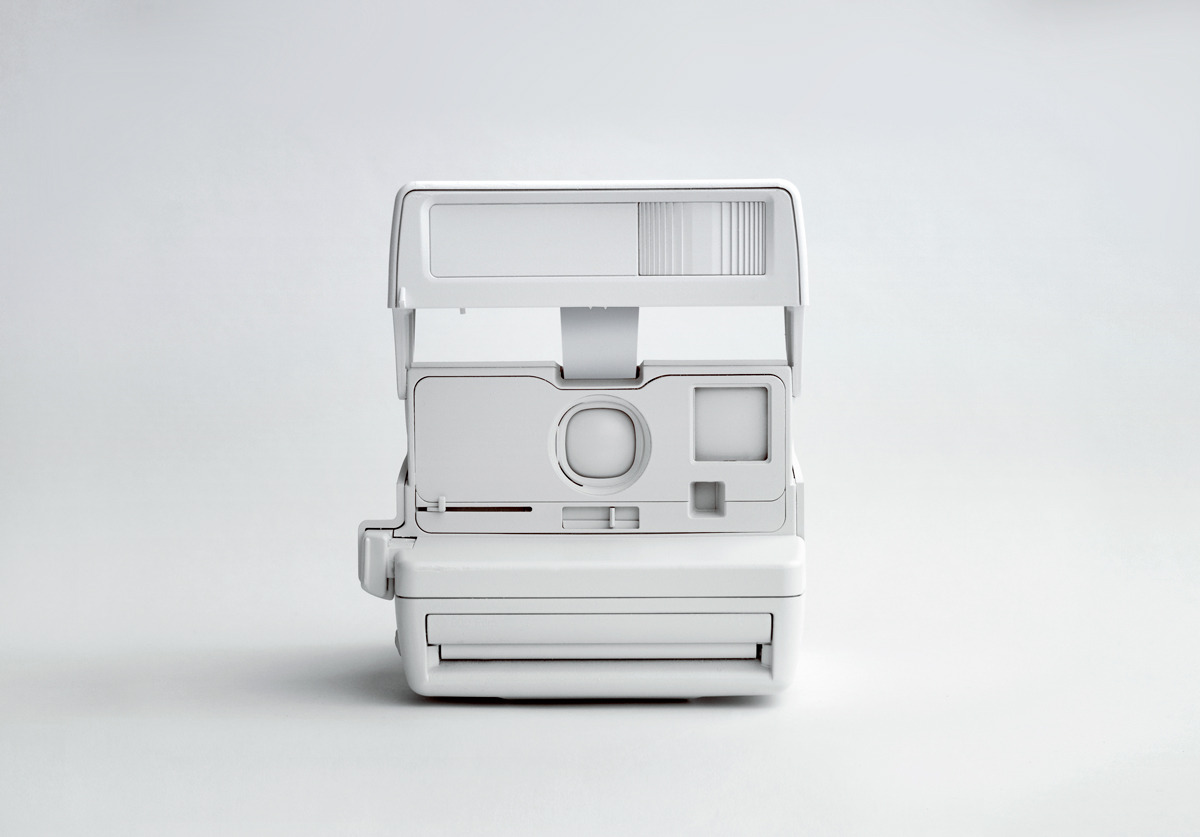 gaksdesigns:  White Polaroid Camera  This is so neat.