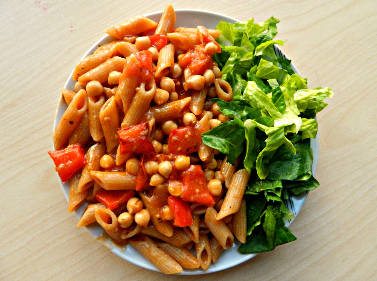 First university meal ever! Wholewheat pasta with roasted cherry tomatoes and red bell pepper (baked in 200C oven with some coconut oil for 1/2 hr), dried basil, tomato purée, black pepper and chickpeas with romaine lettuce.