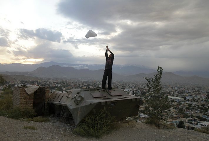 Today in Kabul: boy flies a plastic bag on top of a Soviet-era military vehicle.  It doesn't take much.