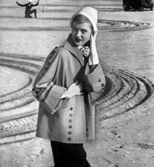 An adorable coat from 1950. I like the dude in the background.