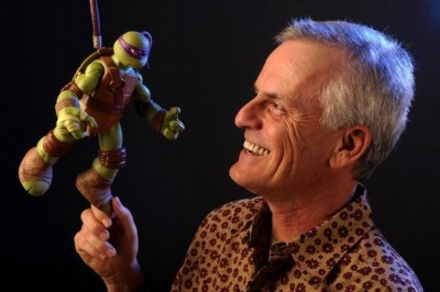 "Rob Paulsen, voice actor extraordinaire (and @yakkopinky on Twitter), hoists a DONATELLO action figure (the character he voices in TMNT mach II) while promoting Nickelodeon's reboot of the TEENAGE MUTANT NINJA TURTLES animated series.  He had previously voiced the hot-headed Raphael (""SHREDDER, YOU TIN-FACED GEEK!"") in the 1987 iteration of the cartoon. I love love LOVE TMNT. I own first printings of the black-and-white Eastman/Laird comic from the 80s. My spirit animal is Michelangelo and indeed, I have that action figure from back in the day. Sadly, fans HATE Michelangelo for some reason. Wow, dudes, chill out. Photo by Rob Varela (Ventura County Star)"