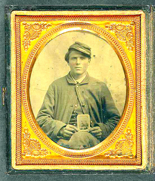 Freeman Mason of Company K, 17th Vermont Infantry holding a tintype of his brother, Michael Mason, killed at Savage's Station, Virginia, in 1862] Digital ID: (digital file from original, tonality adjusted) ppmsca 37071 http://hdl.loc.gov/loc.pnp/ppmsca.37071 Reproduction Number: LC-DIG-ppmsca-37071 (digital file from original, tonality adjusted) LC-DIG-ppmsca-27071 (digital file from original item) Repository: Library of Congress Prints and Photographs Division Washington, D.C. 20540 USA http://hdl.loc.gov/loc.pnp/pp.print