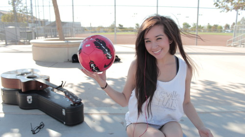 Cathy Nguyen with a soccer ball. tumblr worthy. this is from the other day, while we were recording a video for y'all. =) come see us at our Soccer Tournament. it's free!!! reserve your tickets now. she's on my team. =) http://www.thesupply.org/supplycup/