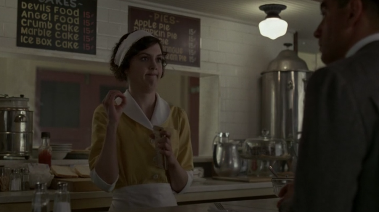 Waitress explains meatballs to an Italian on Boardwalk Empire.