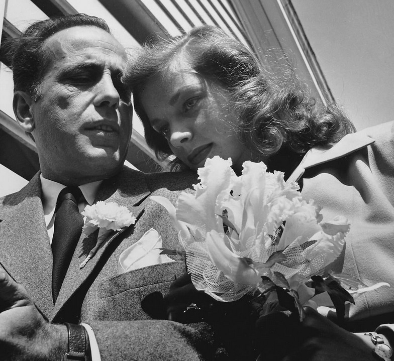 Humphrey Bogart and Lauren Bacall, 1945  Newlywed actors Humphrey Bogart and Lauren Bacall attending their wedding reception at home of novelist Louis Bromfeld.