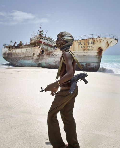 "criminalwisdom:  The end of piracy? Somali heyday seems over as militaries defend against attacks  Faduma Ali, a prostitute in the inland town of Galkayo that became a pirate haven, longs for the days when her pirate customers had money. As she smoked a hookah in a hot, airless room last week, she sneered as she answered a phone call from a former customer seeking her services on credit. ""Those days are over. Can you pay me $1,000?"" she asked, the price she once commanded for a night's work. ""If not, goodbye and leave me alone."" She hung up and groaned out loud: ""Money."" The caller, Abdirizaq Saleh, once had bodyguards and maids and the attention of beautiful women. When ransoms came in, a party was thrown, with blaring music, bottles of wine, the stimulant called khat and women for every man. Now Saleh is hiding from creditors in a dirty room filled with the dust-covered TVs and high-end clothes he acquired when flush."