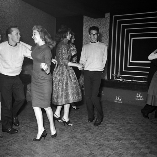 theniftyfifties:  Buddy Holly on the dancefloor during his UK tour, 1958. Photo by Harry Hammond.