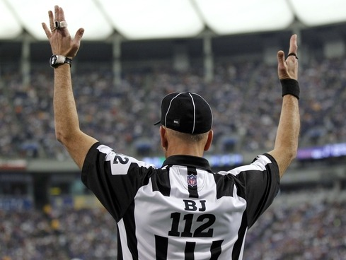 The National Football League's official referees will be back on the field tonight, ending a labor dispute that began in June. After a controversial call cost the Green Bay Packers a win against the Seattle Seahawks on Monday night and two subsequent days of negotiations, the two sides reached a tentative eight-year deal. With the agreement, which is the longest in league history, the refs will receive a raise and back pay for time during the lockout. The NFL also agreed to extend the defined pension plan for five more years until the officials are put on a 401(k) plan. Retirement benefits will also be given to new hires under the deal.