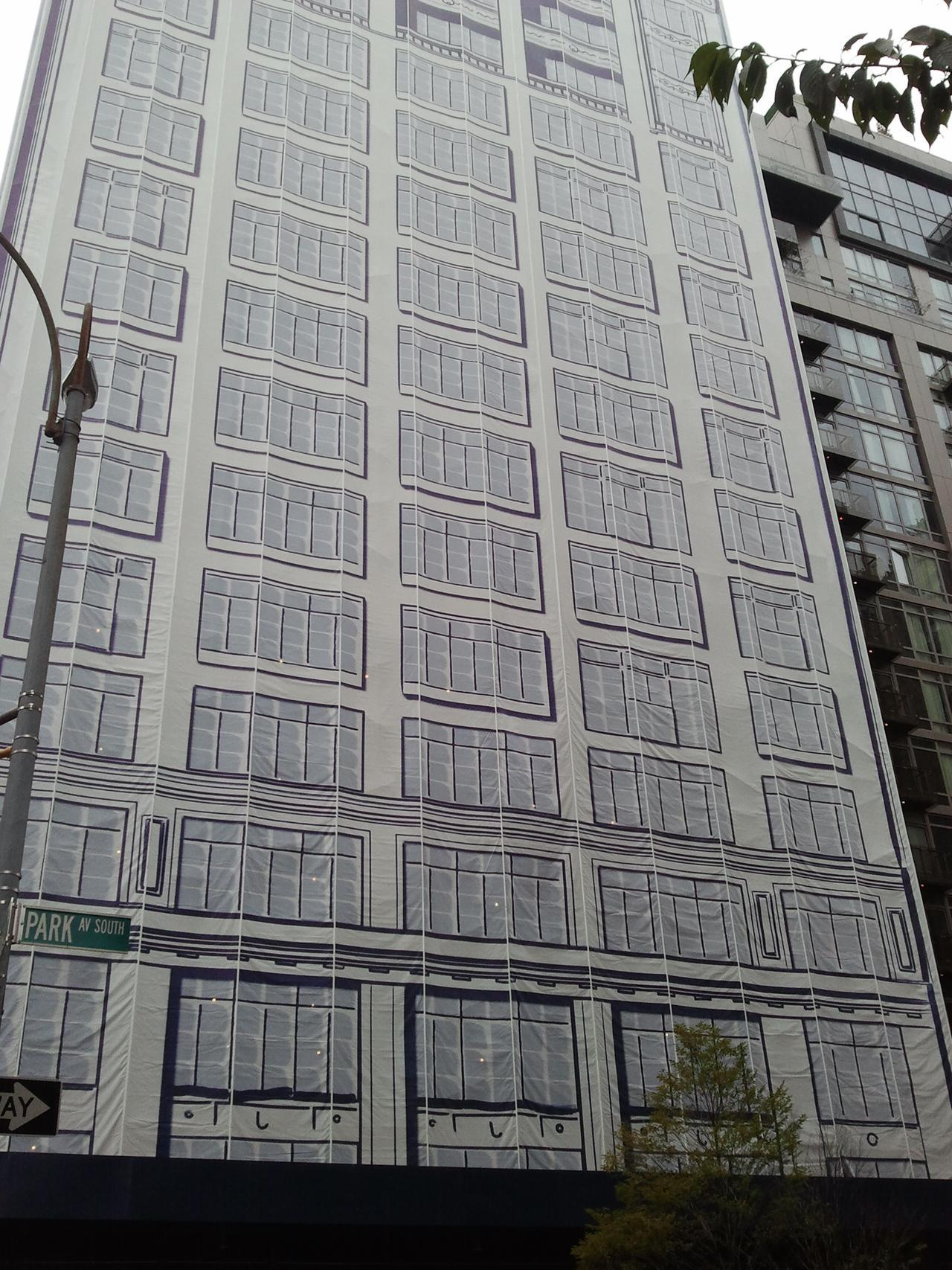 By: Meredith Cohen A Park Avenue building around the corner from our office is under renovation but at first glance you wouldn't know it. The building's façade – from street level to roof – is draped in fabric, printed with a window pattern. The detailing and shadow on the printed fabric tricks the eye into thinking you're looking at a real building. This is a great method to conceal undesirable construction, while using printed materials to liven up an otherwise boring city block.
