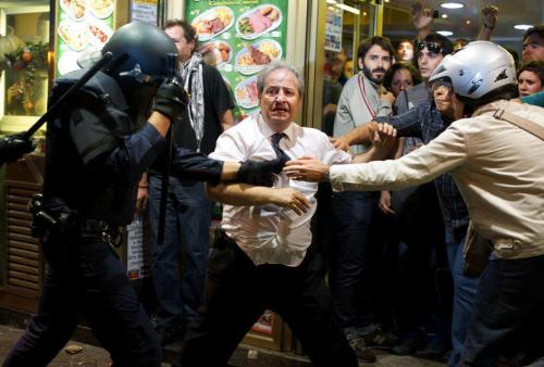 Madrid, Spain: After seeing the actions of the police, the proprietor of this small eatery made a choice to defend protesters by letting them into his establishment. He denied entry to the police and even fed the protesters. He was arrested. A true hero to the people. Solidaridad con el pueblo de Espana!