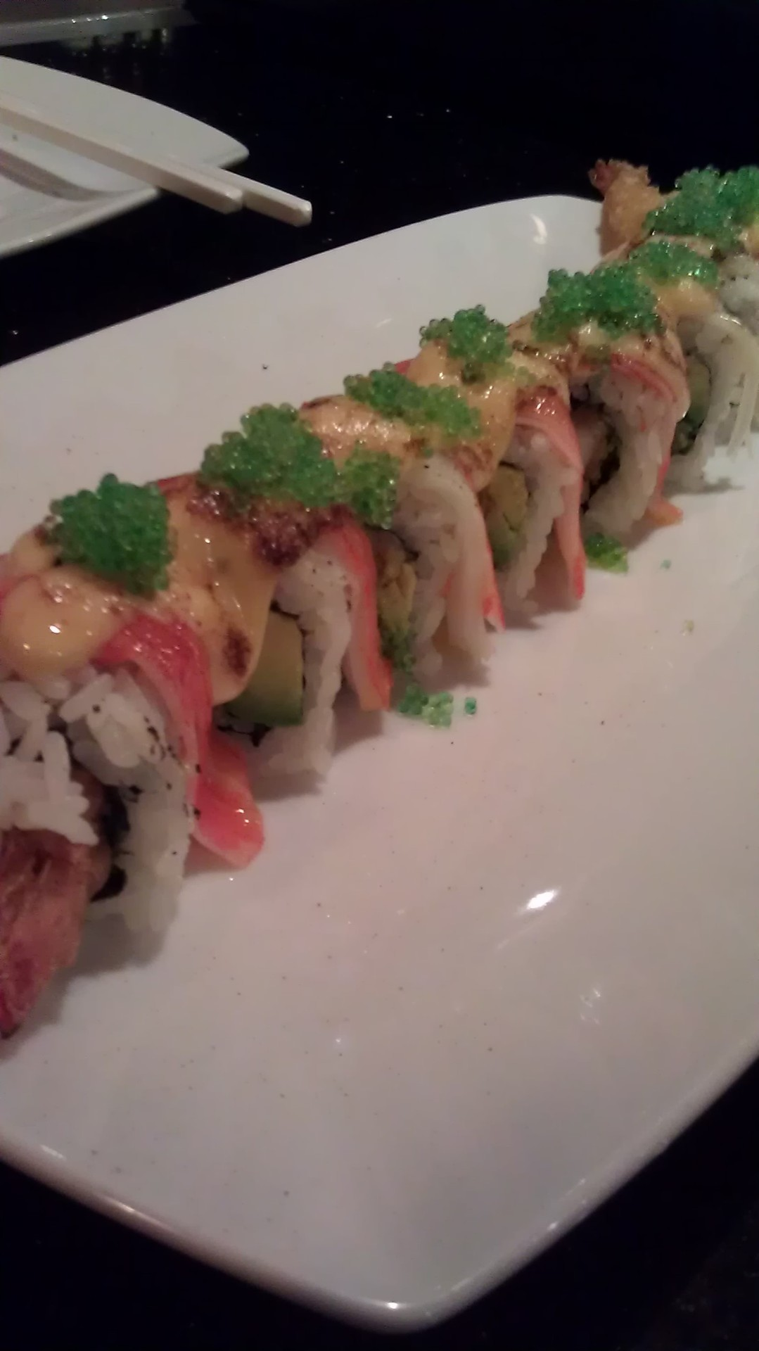 Introducing our newest roll… The Waterfall. Inside - Shrimp Tempura and Avocado. Outside - Spicy Crabstick and green masago.