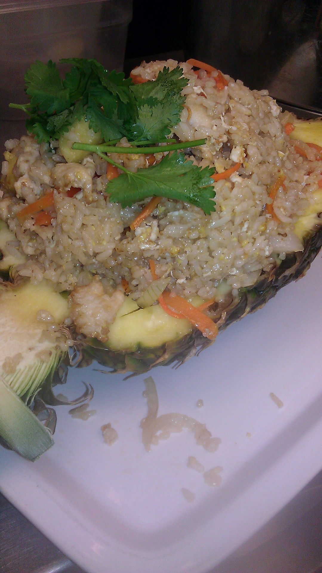 Our Asian Bistro Fried Rice served in a pineapple shell.