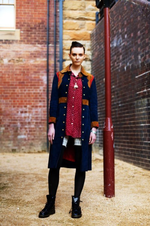 We love the contrast between this Sydney gal's boho-chic vintage coat and her slick rocker hair. (via The Sartorialist)
