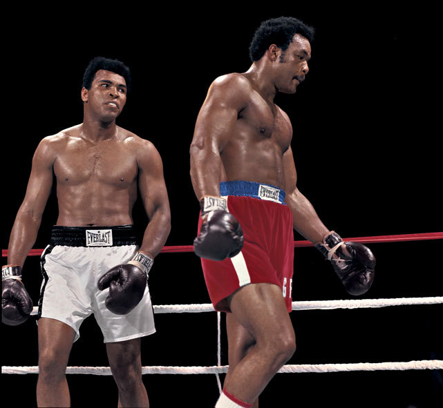 "siphotos:  Muhammad Ali stares down George Foreman during their 1974 ""Rumble in the Jungle"" in Zaire. Ali won by knocking out Foreman in the eighth round. (Neil Leifer/SI) GALLERY: Rare Muhammad Ali Photos 