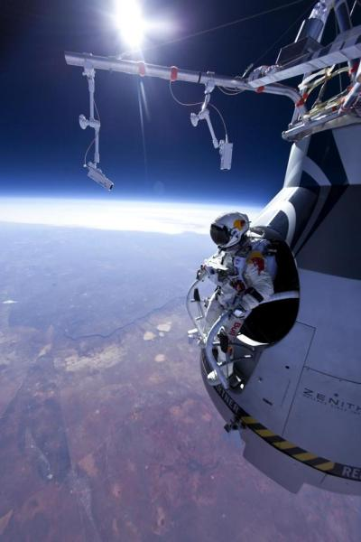 Felix Baumgartner plans to leap from just under 23 miles above the Earth's surface on October 8th, in what will be the world's highest ever skydive. A helium balloon will carry the Austrian to an altitude of 120,000 feet. His jump will break both a 52 year sky-diving record and the sound barrier.Below Baumgartner can be seen preparing for his previous jump, at 71,500 feet on March 15, 2012.