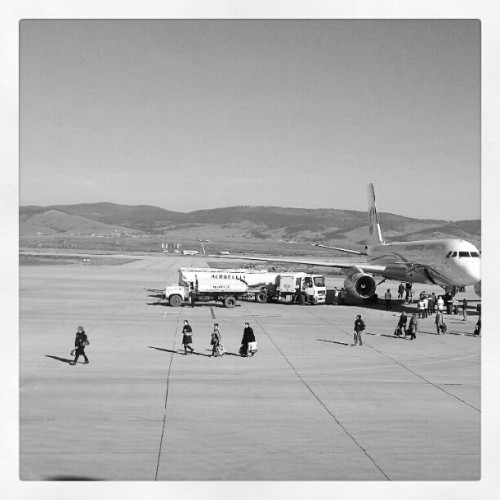 Passangers are leaving aircraft. #Ulan-Ude #Buryatia #Republic #airport #Baikal #airplane #aircraft #landing #strip #parking #leaving #arrival #mountain #dry #village #people #passanger #concrete #flights #aviation #aeroflot #black&white #porusski #superrussia #photomania #photooftheday #imageoftheday #picoftheday #instaddict  (Taken with Instagram at Аэропорт Улан-Удэ / Ulan-Ude Airport)