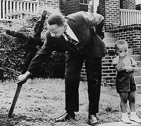 ufo-club:  Martin Luther King Jr removing a burned cross from his front yard with his son at his side. Atlanta Ga 1960.