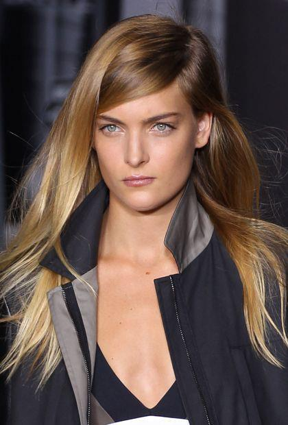 Trend alert: super deep side part. To copy, choose which side you want your part to fall on and follow the imaginary line from the end of that eyebrow up toward your hairline. Use a rattail or teasing comb.