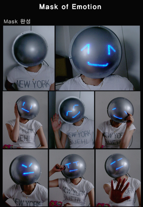 "archiemcphee:  This awesome mask, called the ""Mask of Emotion,"" is a project created by the Digital Media Design Department at Hongik University in Seoul, South Korea.  The mask conveys a variety of facial expressions using LEDs that light up to form different emoticons. The default setting is a completely blank or expressionless face. But when someone shakes hands with the wearer, the mask smiles in response to the greeting.  ""The project was designed to hide personal emotions by eliciting a different set of public facial expressions that could be used to generate conversation and response in public spaces.""  This mask might be just the ticket for those of us who spend so much time texting and chatting online that the urge to emote using keyboard characters arises even when interacting with someone in person.  [via Makezine] Today is Posts That Relate to Product Categories on Archie McPhee Day on Geyser of Awesome!"