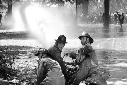 "oneluv918:  collective-history:  Firemen hose demonstrators in Kelly Ingram Park near 16th Street Baptist Church, Martin Luther King Jr's headquarters for demonstration. Hosing was ordered by ""Bull"" Connor, the Birmingham Police Commissioner, 1963, by Bob Adelman  I will vote in honor of those who took a stand for my right to do so."