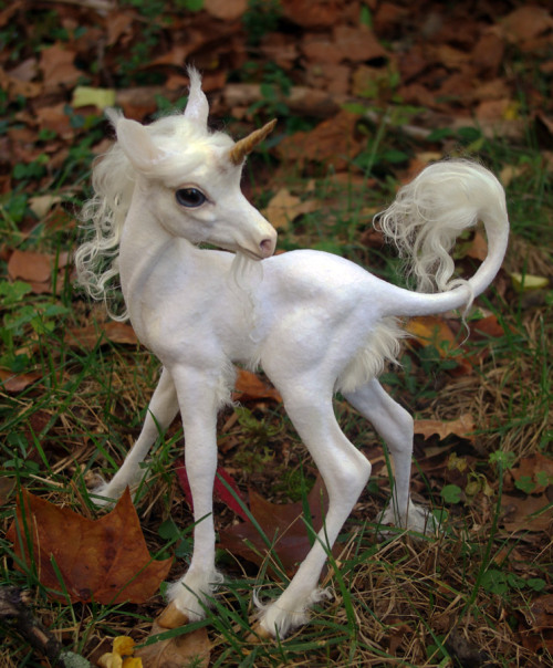 "archiemcphee:  This incredibly lifelike little unicorn, who looks ready to scamper, cavort, and make all of your dreams come true, is a sculpture, entitled Aura, created by R. Wake, an artist who goes by the name Indigo-Ocean on DeviantArt. Aura stands 12"" tall and was made using copper tube, aluminium and steel wire armature, Padico Premier stoneware clay, taxidermy glass eyes, recycled mohair, rayon flocking, silicone ears/facial features, resin, and polymer clay. We can't look away. We know this is just a photo and that the photo is of a sculpture, but we can't shake the feeling that this awesome unicorn is about to blink."