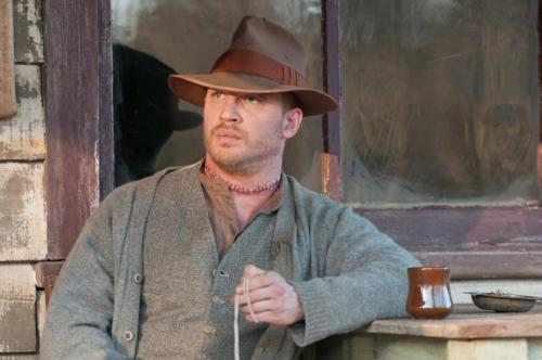 "Lawless is released on DVD/Bluray on Nov 27! And contains the following extras: Audio Commentary with director John Hillcoat and author Matt Bondurant Featurette: ""The True Story of the Wettest County In The World"" Featurette: ""Franklin County, VA: Then and Now"" Willie Nelson's ""Midnight Run"" music video Deleted Scenes DVD/Digital Copy of the film Deleted scenes! Yay! I hope it's all Forrest & Maggie being beautiful together. Tom did say there was a whole mini-series worth of stories and scenes, after all… But oh, how I wish Tom would sometimes have the time to do commentary on a film!"