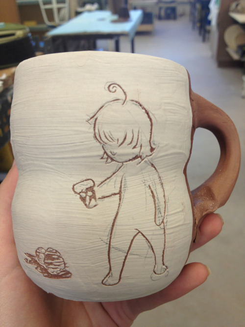 In progress cup.  White slip on red earthenware