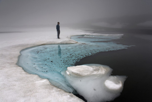 travelingcolors:  Iceland by Andri Elfarsson  This image is shot standing on melting ice over Bræðravatn, Mjóafjarðarheiði. The locals tell me this is never to be done again. The name, Lake of Brothers, comes from two brothers who drowned in the extremely deep and cold water after the ice broke.