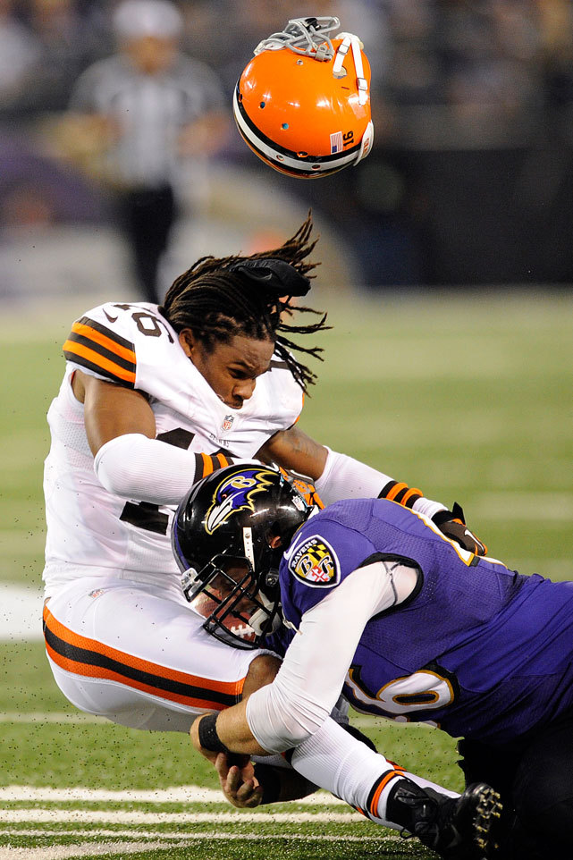 Josh Cribbs loses his helmet after a hit from Morgan Cox during Thursday's Ravens-Browns game. Despite playing their fourth game in 18 days, Baltimore defeated Cleveland 23-16. The Browns fell to 0-4 with the loss and remain the only winless team in the AFC. (AP Photo/Nick Wass) BURKE: Browns winless but not hopelessKING: Week 4 picks | Fantasy projections