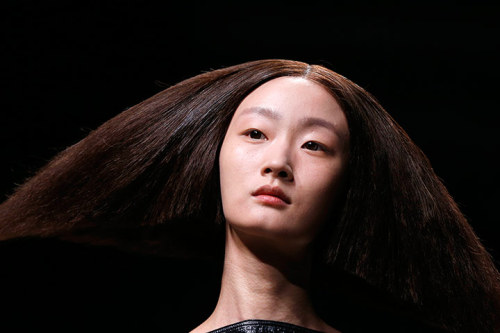 Paris, France: A model wears a distinctive haircut during the Rick Owens spring/summer 2013 ready-to-wear collection show at Paris fashion week Check out the rest of our 24 hours in pictures gallery: a round-up of some of the most compelling images from around the globe Photograph: Francois Guillot/AFP/Getty Images