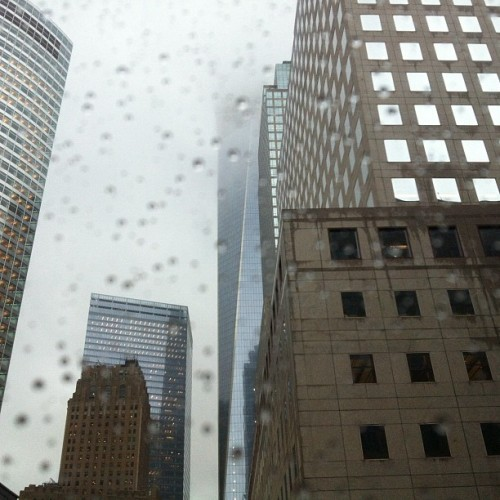Rainy day view from my office window as the Freedom Tower becomes enveloped by the sky. (Taken with Instagram at New York Mercantile Exchange - CME Group)