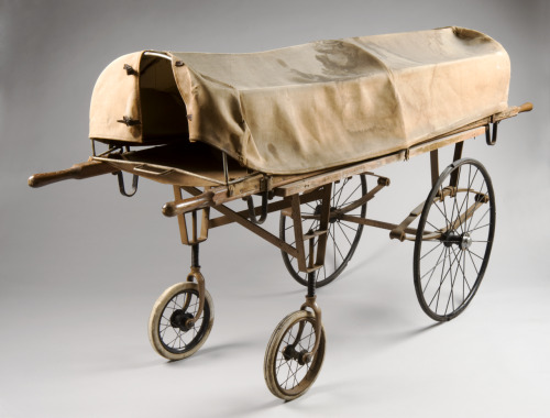 catafalques:  Covered mortuary trolley, England, 1895-1905: Underneath this stained canopy was placed the body of a deceased person before removal to a mortuary. The stretcher can be used separately from the wheeled base and it would have been secured upon the metal frame before being manoeuvred to the mortuary. The trolley is made of wood and metal and has solid rubber wheels. It dates from the early 1900s and has been well used because the front wheels have been replaced with more modern equivalents. The trolley was donated to the Science Museum collections in 1979 by King Edward VII Hospital in central London.