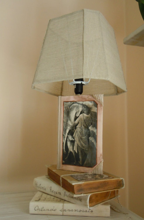 Table lamp made with books! Definitely on my wish list. Found it here http://www.etsy.com/shop/BibliotecAlessandria