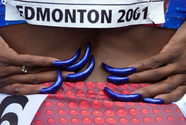 Gail Devers shows off her fingernails before a 2001 race in Edmonton. (AFP Photo) GALLERY: Best Fingernails in Sports