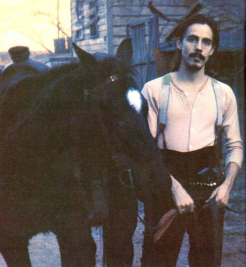 Jackson Browne and a horse.