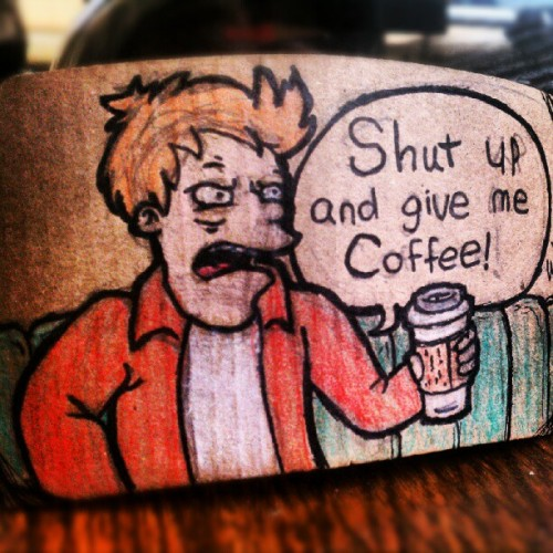 chip-magnet:  Even more coffee sleeve art! This time with a little bit of color. #Futurama #coffee #art #cartoons #comics #coffeesleeveart #coffee art (Taken with Instagram)  Not sure if I like this because I like Futurama… …or just because I'm addicted to coffee.