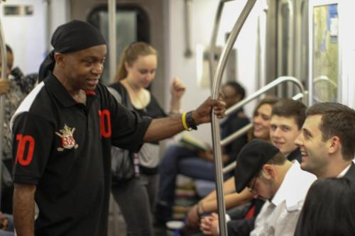 "humansofnewyork:  This guy was just walking through the subway car, saying hilariously awkward things to people. He got down on one knee and started singing to the girl on the end of the row. When he finished the song, he explained: ""In twenty years, we're going to laugh about how I sang to you when we first met."" Then he walked over to the guy in the foreground, pointed at the girl next to him, and said: ""You two should really hook up."""