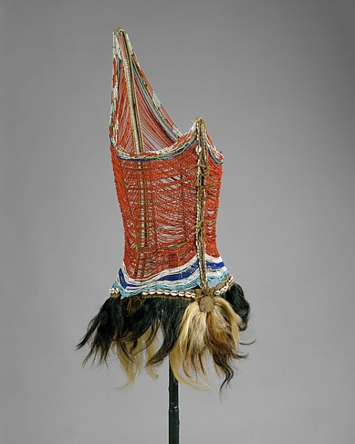 Men's beaded bodice, Dinka peoples, South Sudan, mid-20th century, glass beads, animal skin, wood, cowry shells. For other examples click here and here.