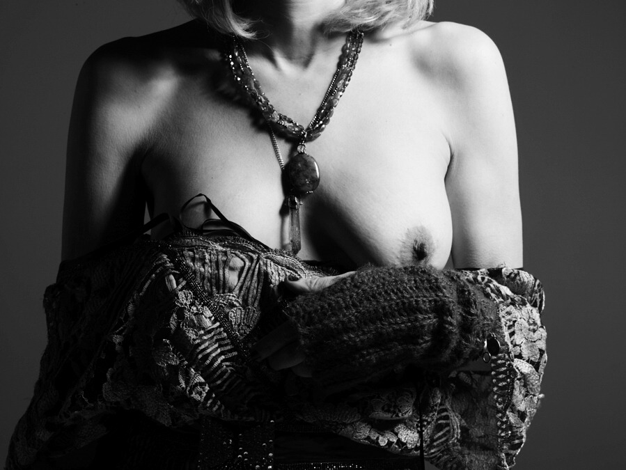 a black and white photo of courtney love's titty