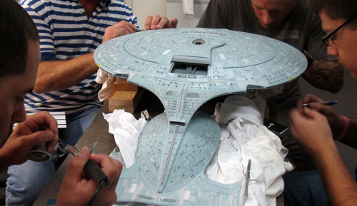 startrekships:  Behind the Scenes: QMX Model Shop Team with working on Enterprise D replica NEED  Oh man