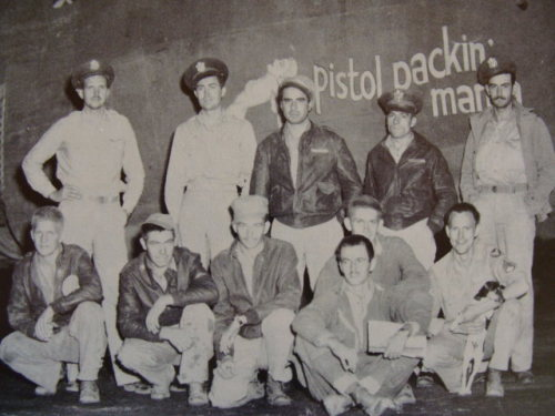 Lewis N. Ellis and the crew of the B24 'Pistol Packin' Mama' with Peanuts the dog, their mascot.