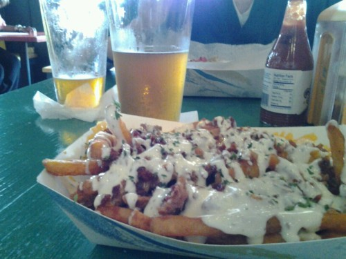 NOLA blonde and bacon, cheddar, ranch fries at Dat Dog. Great combo. Plus they were celebrating national drink a beer day and ran happy hour all day. Yum.