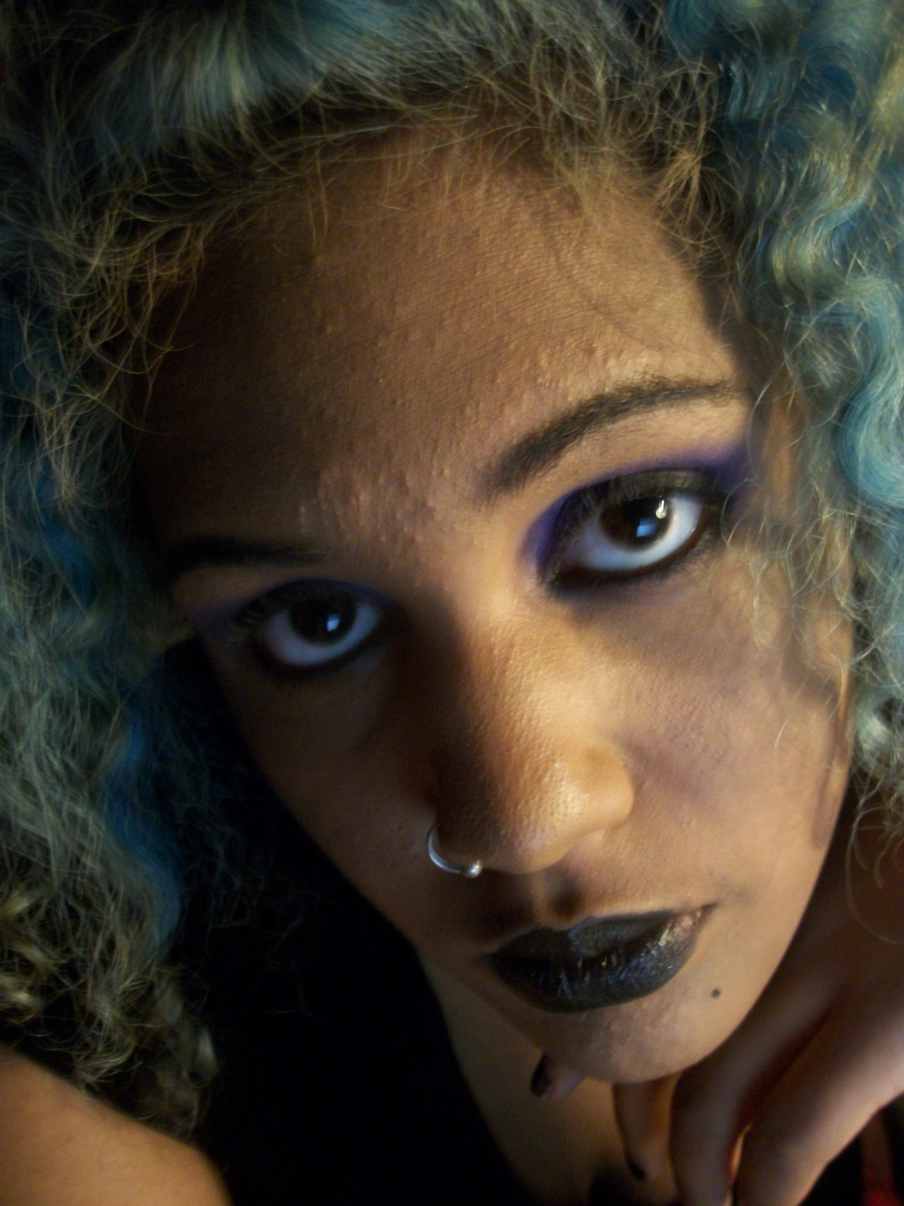 [image: mixed goth with curly blue hair, purple eye makeup, and black lipstick]