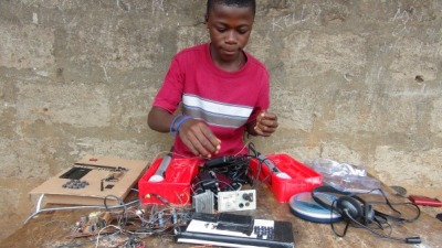 "radiogoogooradiogaga:  This teenager named Kelvin Doe from Sierra Leone built his own radio station. Let me say that again: he built a radio station. And that's not even the best bit. This is: he built it using scrap electronics that he found in junk heaps. I don't even really understand what it means to build a radio station (which includes a generator, amplifier, and ""other components,"" according to this blog post), but I know that it sounds awesome. Too bad I can't attend the lecture Doe will be making to the Harvard School of Engineering to find out more.   If you're in New York you can see what Doe is up to at the Maker Faire."